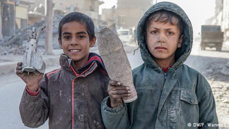 Two boys holding spent shells