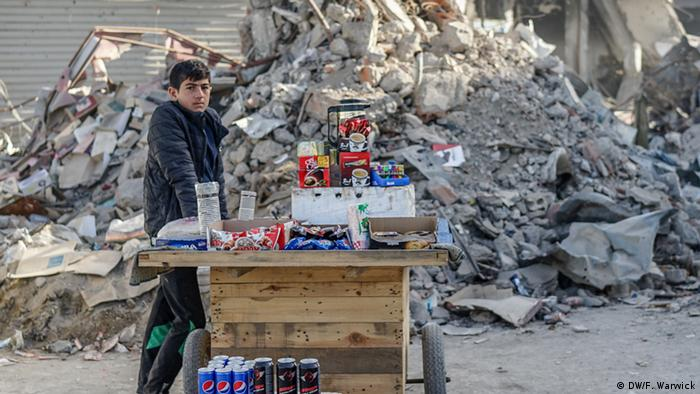 A boy in Raqqa with a food and drinks cart