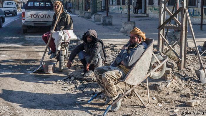 Workers take a break in Raqqa