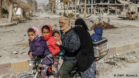 A family in Raqqa on a motorbike