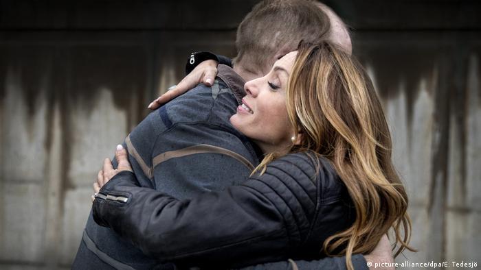 Alexandra Pascalidou and former neo-Nazi Martin Karlsson hug