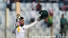 Bangladesh cricketer Mominul Haque reacts after scoring a century (100 runs) during the first day of the first cricket Test between Bangladesh and Sri Lanka at Zahur Ahmed Chowdhury Stadium in Chittagong on January 31, 2018. / AFP PHOTO / MUNIR UZ ZAMAN (Photo credit should read MUNIR UZ ZAMAN/AFP/Getty Images)