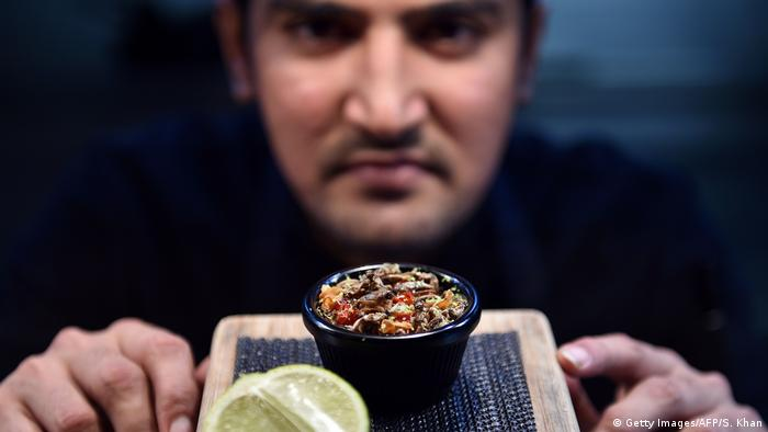 Sous-chef Nowshad Alam Rasel displaying a cricket dish