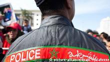 صورة رمزية يظهر فيها عنصر شرطة مغربي.