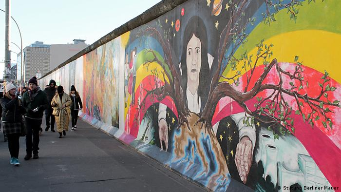 Part of the East Side Gallery with bright paintings on the Berlin Wall (Stiftung Berliner Mauer)
