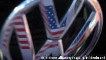 Symbolbild Dieselgate VW Logo mit US-amerikanischer Flagge