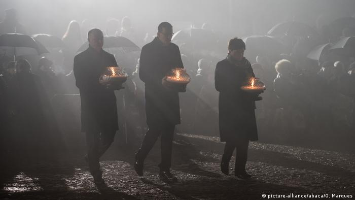 Polish PM Mateusz Morawiecki (C) at the International Monument to the Victims of Fascism at Auschwitz II-Birkenau marking the 72nd anniversary of the liberation of the camp on January 27, 2018
