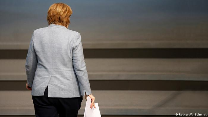 Chancellor Angela Merkel leaving parliament