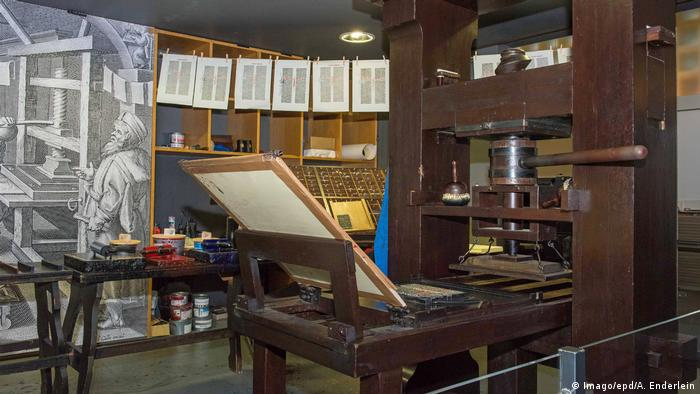 A reconstructed printing press sits in a museum