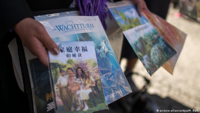 Jehovah's Witnesses hand out leaflets