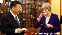BEIJING, CHINA - FEBRUARY 01: British Prime Minister Theresa May and Chinese President Xi Jinping take part in a Tea Ceremony at Mr Jinping's official Diaoyutai State Guesthouse on February 1, 2018 in Beijing, China. Theresa May, who is on a three day visit to China met Chinese President Xi Jinping to discuss matters including the environment, investment, education, Hong Kong and North Korea. (Photo by Dan Kitwood - Pool/Getty Images)