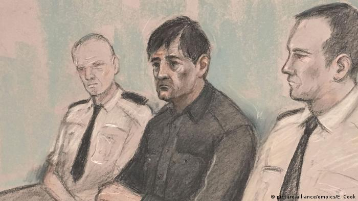 Darren Osborne seated next to two police officers