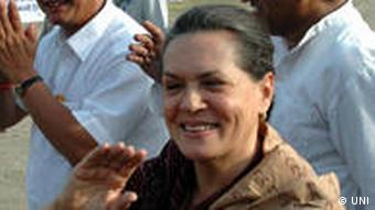 Congress President Sonia Gandhi greeting people at a rally at Parade Ground in Dehradun