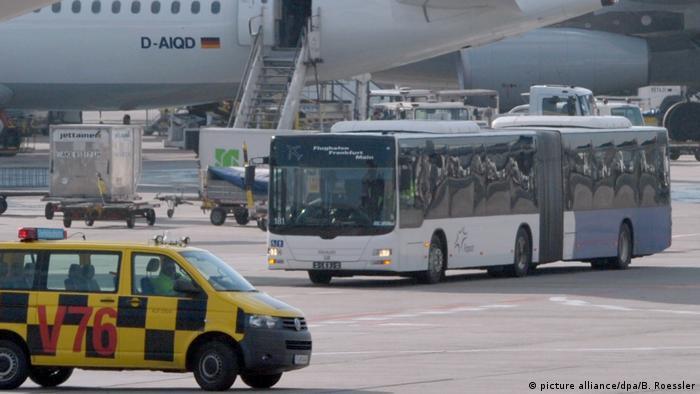 A bus near a plane at Frankfurt Airport