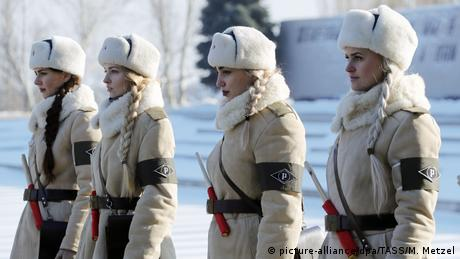 Ladies dressed in Soviet WWII uniforms of traffic control officers as Russian President Vladiimir Putin lays a wreath in the Hall of Military Glory of the Mamayev Kurgan memorial complex commemorating the Battle of Stalingrad to mark the 75th anniversary of the victory in the battle