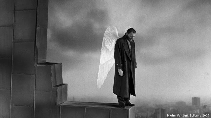 a winged man watches over a city (Wim Wenders Stiftung 2017)