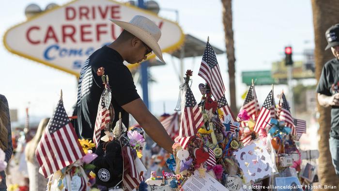 A Las Vegas shooting survivor visits a memorial to the victims