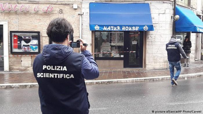 Italian forensic police photograph the site where the shootings began.