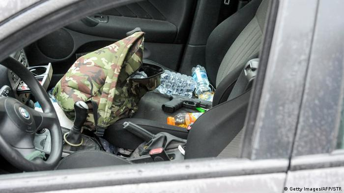 A Glock handgun sits on the passenger seat of the shooting suspect's car.