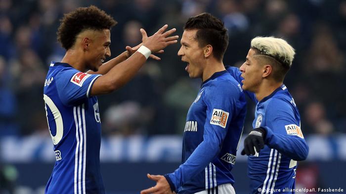 Schalke's Thilo Kehrer (l), Yevhen Konoplyanka and Amine Harit (r) celebrate taking a 1-0 lead against Werder Bremen. 03.02.2018, photo: Ina Fassbender/dpa.
