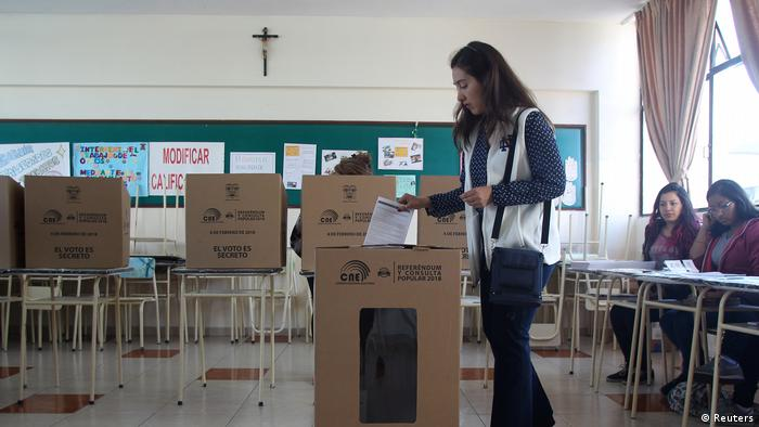 A woman casts her vote in a referendum on presidential terms in Ecuador (Reuters)