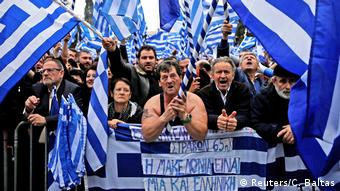 Protesters waving Greek flags