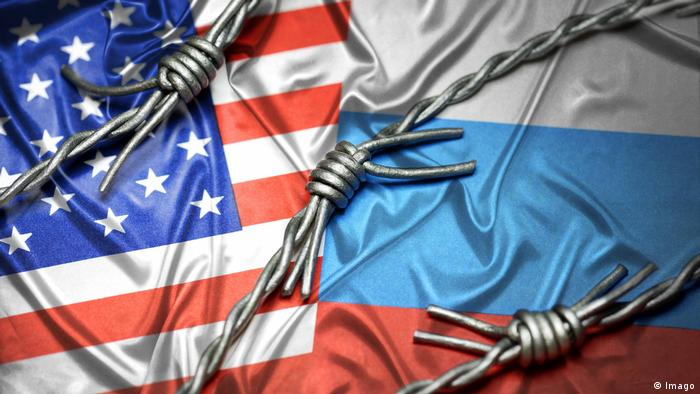 US and Russian flags in barbed wire (Imago)