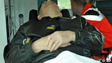 A man believed to be suspected Nazi death camp guard John Demjanjuk is seen inside an ambulance car as it arrives in front of the Stadelheim prison in Munich, southern Germany, on Tuesday, May 12, 2009. The Ukrainian-born Demjanjuk on Tuesday arrived in Germany where faces a warrant accusing him of being accessory to the murder of 29,000 Jews and others at Sobibor. The retired Ohio autoworker was deported from the United States and arrived Tuesday morning on a private jet at Munich's airport. (AP Photo/Uwe Lein)