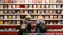Germany: Frankfurt Book Fair 2017 Day 2 Visitors look at books on shelves on the booth of the German publisher Taschen. The Frankfurt Book Fair 2017 is the world largest book fair with over 7,000 exhibitors and over 250,000 expected visitors. It is open from the 11th to the 15th October with the last two days being open to the general public. Frankfurt Hesse Germany Messe Frankfurt PUBLICATIONxINxGERxSUIxAUTxONLY MichaelxDebets