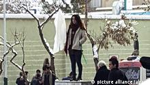 """Narges Husseini, """" The girl of Enghelab Street"""". ( The girl of Revolution street) removed her white scarf in the middle of the street and waived it on a stick, Following this same courages protest, another woman last night was arrested, The women appear to be following the lead ofVida Movahed the protester, who took off her headscarf on the same street in December.women in Iran protesting the obligatory Islamic headscarf by taking theirs off and waving them on sticks.the movement against strict Islamic law is growing in Iran as women take to the street and social media with an act of defiance, Tehran. Iran. 23/12/2017 Photo by Salampix/ABACAPRESS.COM 