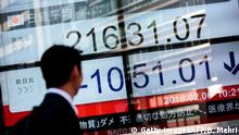06.02.2018+++ A man walks past an electronics stock indicator showing share prices at the Tokyo Stock Exchange in Tokyo on February 6, 2018. Tokyo stocks plunged more than five percent on February 6 with investor sentiment hit by a sell-off on Wall Street and the yen's surge against the dollar. / AFP PHOTO / Behrouz MEHRI (Photo credit should read BEHROUZ MEHRI/AFP/Getty Images)