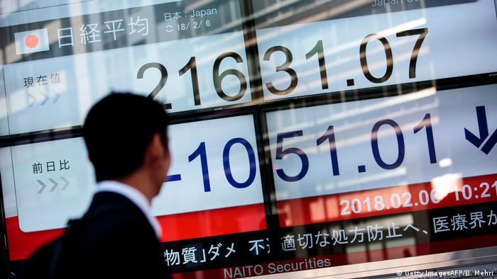 A man walks past the Tokyo stock exchange