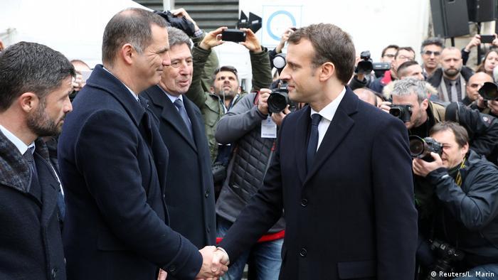 Emmanuel Macron and Gilles Simeoni