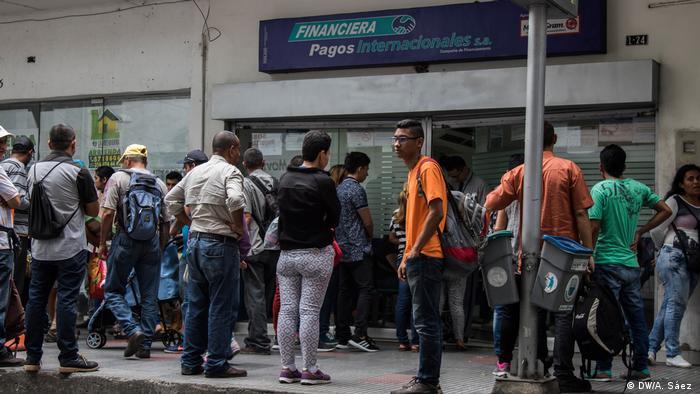 Venezuelans lining up to exchange money in Cucuta, Colombia