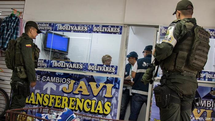 Venezuelans facing economic crisis cross border to secure cash