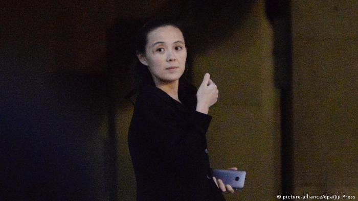 A woman thought to be Kim Yo Jong, pictured holding a smart phone in Pyongyang in May 2016/