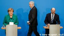 BERLIN, GERMANY - FEBRUARY 07: German Chancellor and leader of the German Christian Democrats (CDU) Angela Merkel (L), leader of the German Social Democrats (SPD) Martin Schulz (R) and Bavarian Governor and leader of the Bavarian Christian Democrats (CSU) Horst Seehofer (C) arrive to speak to the media after the government coalition negotiations at CDU headquarter on February 7, 2018 in Berlin, Germany. The contract, reached after weeks of arduous negotiations, paves the way for a grand coalition of the two strongest parliamentary factions and the creation of the next German government. (Photo by Carsten Koall/Getty Images)
