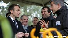 07.02.2018 +++ French President Emmanuel Macron (L) listens to scientists as he visits the National Institute for Agronomic Research of San-Giuliano near Bastia, on the French Mediterranean island of Corsica, February 7, 2018. REUTERS/Raphel Poletti/Pool