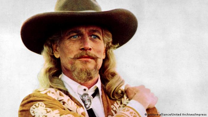 Paul Newman with shoulder-length blond hair and a cowboy hat (picture alliance/United Archives/Impress)