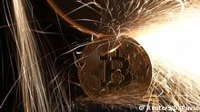 Sparks glow from broken Bitcoin (virtual currency) coins in this illustration picture, December 8, 2017. Picture taken December 8. REUTERS/Dado Ruvic/Illustration