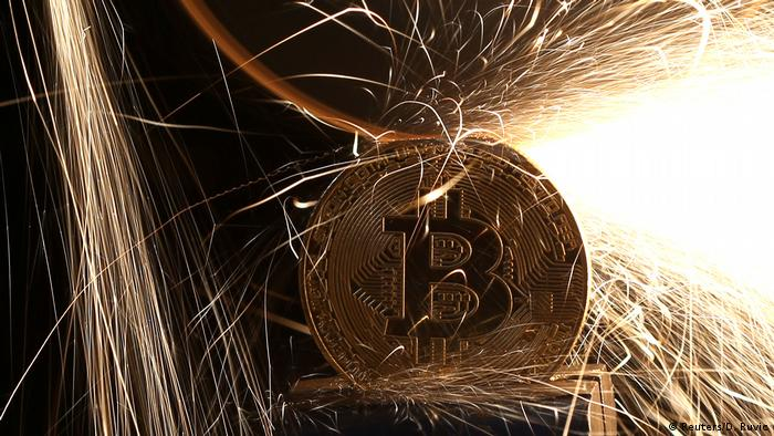 Sparks glow from broken Bitcoin (virtual currency) coins in this illustration picture