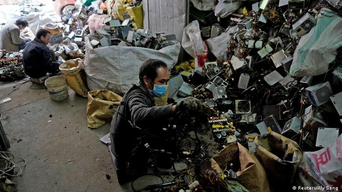 Photo: Employees sort through waste in Guiya