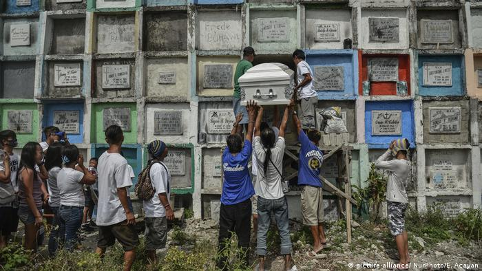 Filipino men carry the coffin of a victim of the 'drug war'