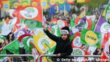 A young woman waves a HDP party flag