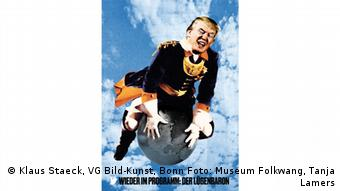 Trump on the earth in a poster by Klaus Staeck (Klaus Staeck, VG Bild-Kunst, Bonn Foto: Museum Folkwang, Tanja Lamers)