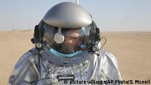 This Feb. 7, 2018, photo shows João Lousada, a flight controller for the International Space Station, wearing an experimental space suit during a simulation of a future Mars mission in the Dhofar desert of southern Oman. The desolate desert in southern Oman resembles Mars so much that more than 200 scientists from 25 nations organized by the Austrian Space Forum are using it for the next four weeks to field-test technology for a manned mission to Mars. (AP Photo/Sam McNeil) |