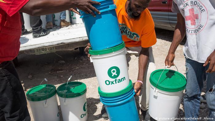 Oxfam workers distributing hygiene kits