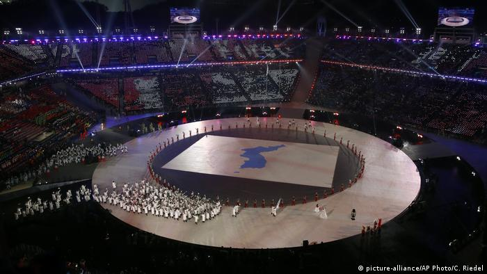 North and South Korean athletes enter the 2018 Winter Olympic opening ceremony under the unified Korea flag