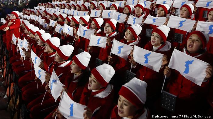 Members of the North Korean delegation hold the flag of the combined Koreas before the Olympic Opening Ceremony