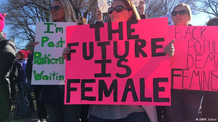A demonstrater holds up a sign that reads 'The future is female'